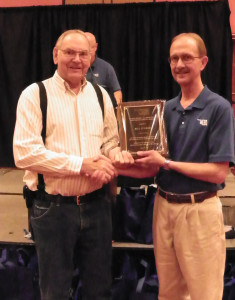 Bill Tucker, Kingfisher City Clerk receiving the Marvin Hicks-Al Middleton Meritorious Service Award from  MESO Board President Dean Sherrick